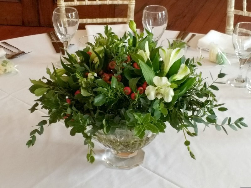Christmas table flowers in glass bowl