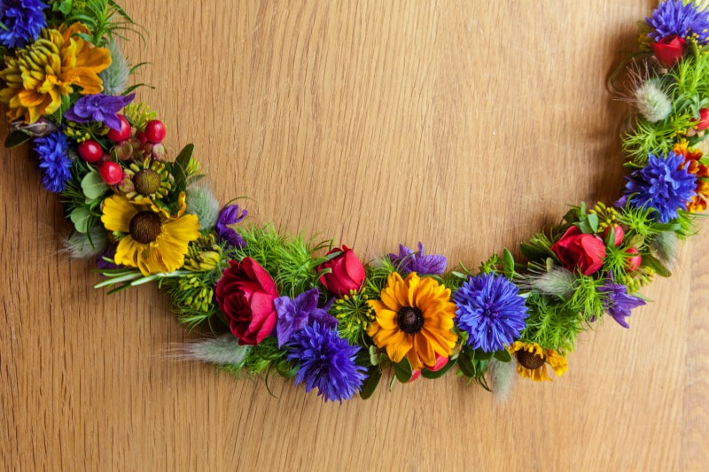 Flower crown made in rich bright colours red, gold & blue