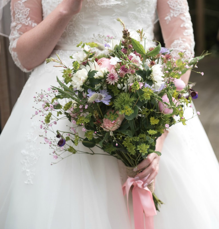 Natural bridal bouquet of wild country flowers
