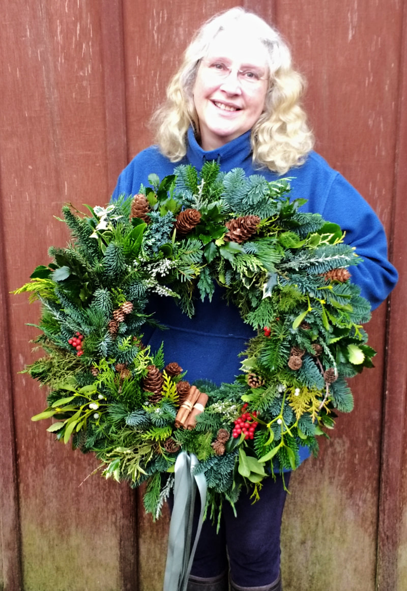 Rosie Gray, Galloway Flowers with handmade Christmas Wreath copyright www.GallowayFlowers.co.uk