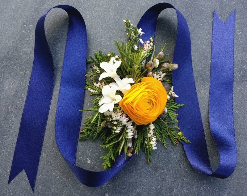 Stunning floral wrist corsage in yellow, white & navy blue
